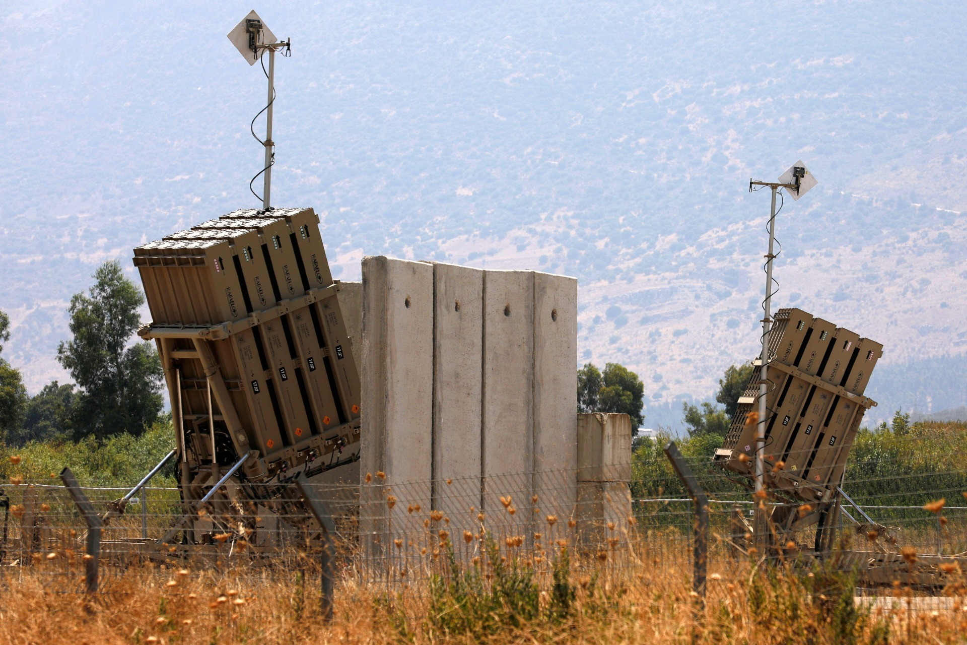 A picture taken on August 5, 2021, shows an Iron Dome defense system battery, designed to intercept and destroy incoming short-range rockets and artillery shells, in the Hula Valley in northern Israel near the border with Lebanon. - The Israeli air force said it carried out its first air strikes on neighbouring Lebanon in seven years today following a second day of rocket fire across the border. (Photo by JALAA MAREY / AFP) (Photo by JALAA MAREY/AFP via Getty Images)