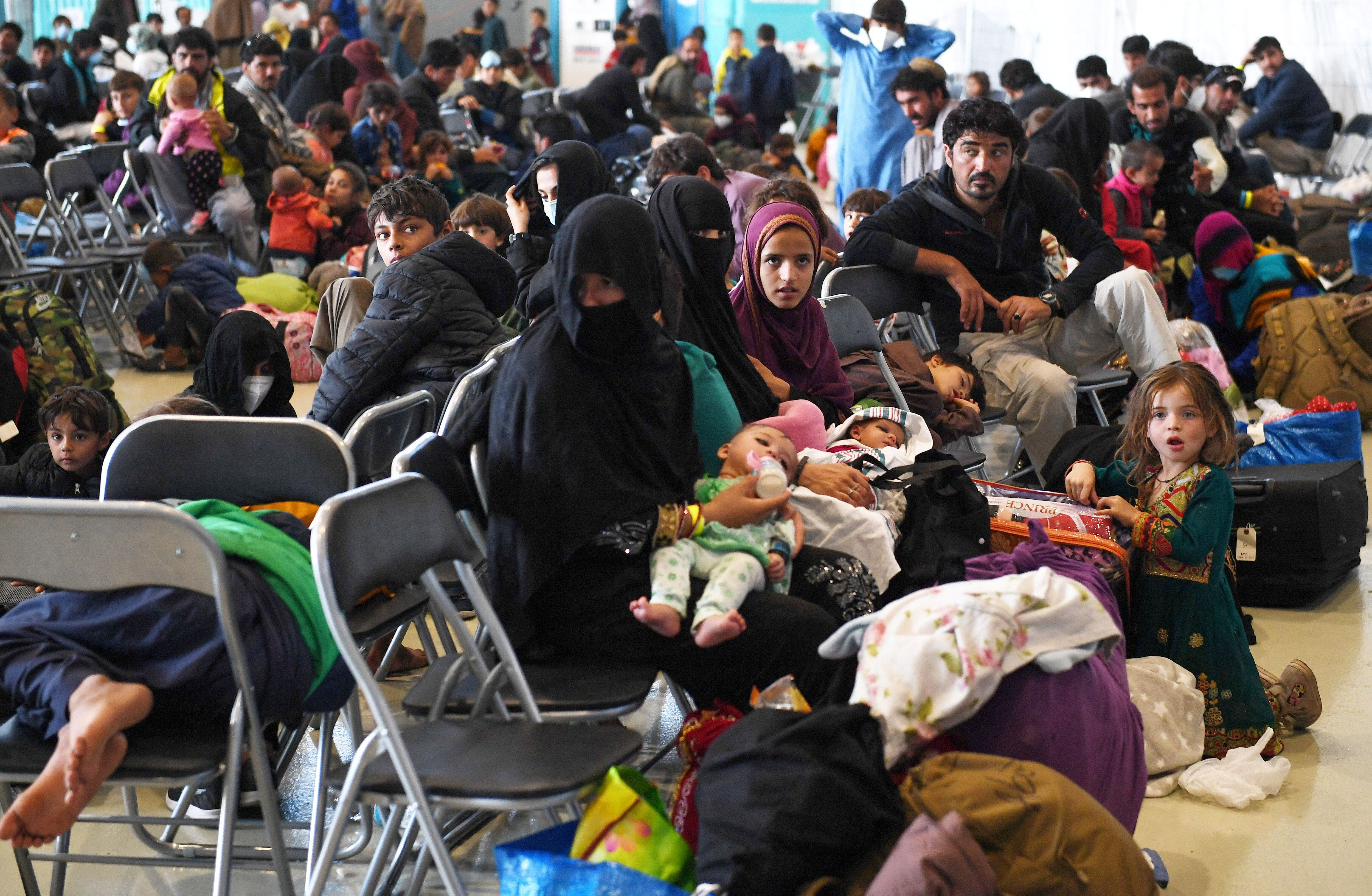 Afghan refugees are processed inside Hangar 5 at Ramstein Air Base in Germany on Sept. 8, 2021.