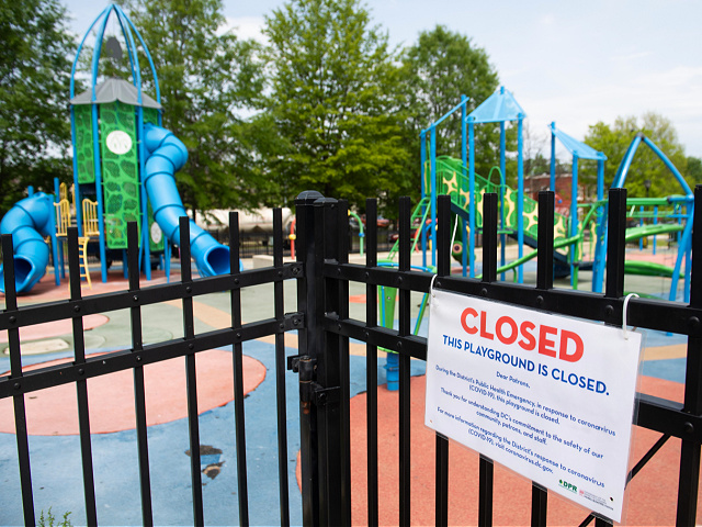 A signs hangs outside a closed playground in Washington, DC, April 29, 2020. - Washington will uphold coronavirus restrictions through May 15, 2020. (Photo by SAUL LOEB / AFP) (Photo by SAUL LOEB/AFP via Getty Images)