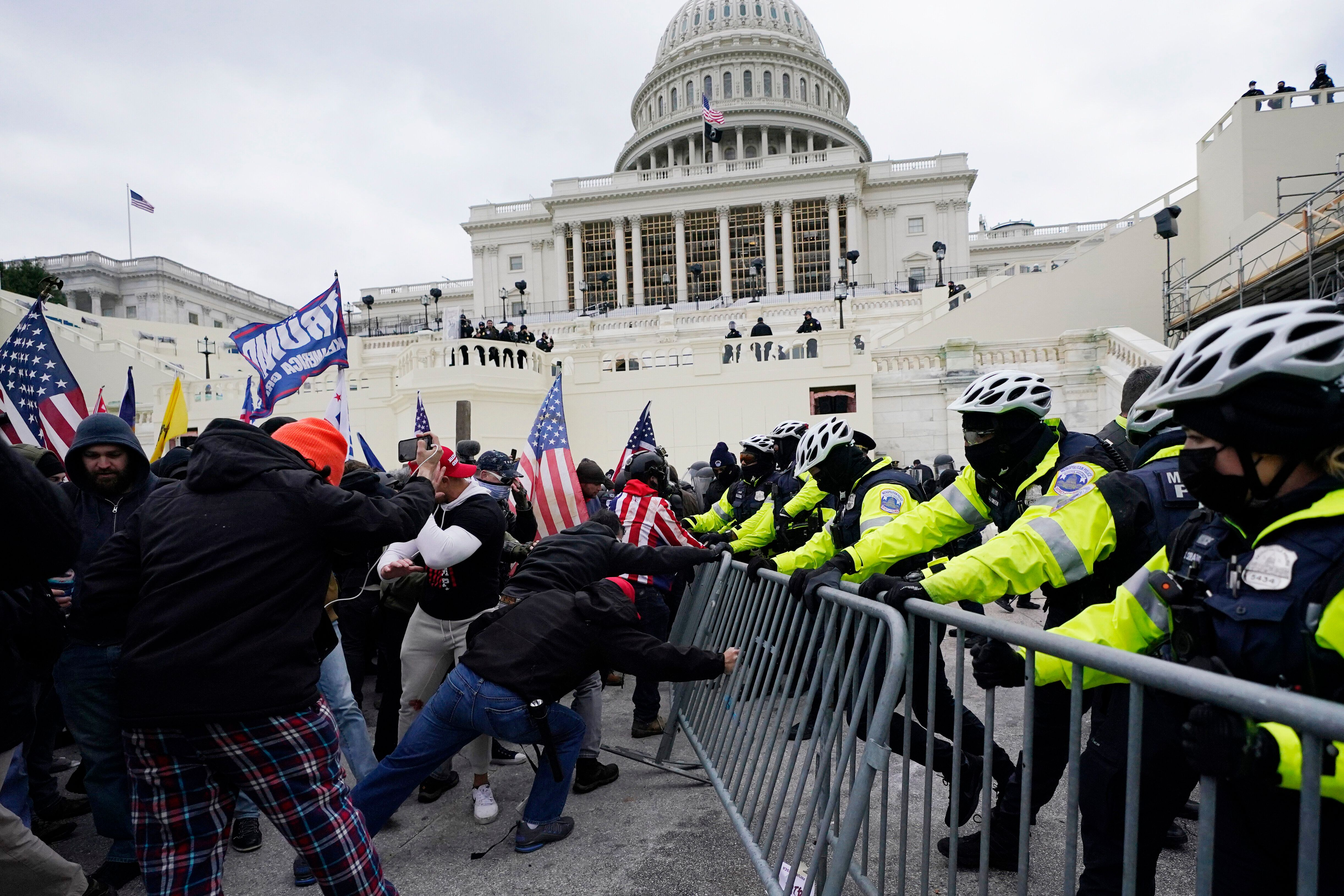Donald Trump supporters try to break through a police barrier at the U.S. Capitol on Jan. 6. The former president has said he