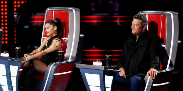 Ariana Grande and Blake Shelton appear as coaches on 'The Voice.' Grande replaced Nick Jonas as a judge for season 21.