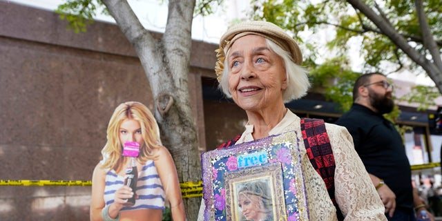 Britney Spears supporter Mona Montgomery of Glendale, Calif., demonstrates outside the Stanley Mosk Courthouse, Wednesday, Sept. 29, 2021, in Los Angeles.
