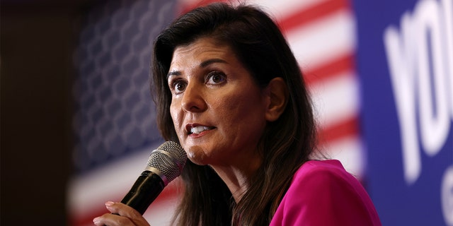 Nikki Haley, the former Governor of South Carolina and Ambassador to the UN, stumps for Virginia gubernatorial candidate Glenn Youngkin (R-VA), during a campaign event in McLean, Virginia, July 14, 2021. REUTERS/Evelyn Hockstein
