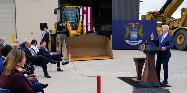 """President Biden delivers remarks on his """"Build Back Better"""" agenda during a visit to the International Union Of Operating Engineers Local 324, Tuesday, Oct. 5, 2021, in Howell, Mich. In foreground at left is U.S. Rep. Elissa Slotkin, D-Mich."""